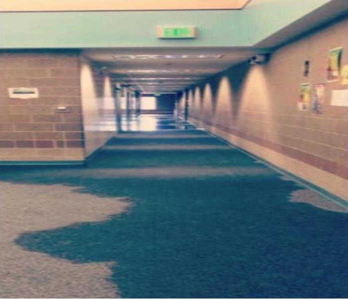 School hallway with wet carpet