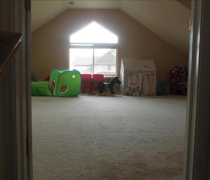 attic room with wet carpet