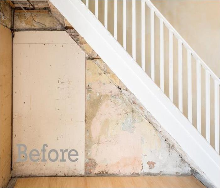 staircase with mildew and water damage