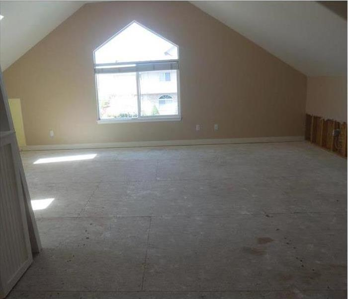 room with out carpet and sheetrock cut out