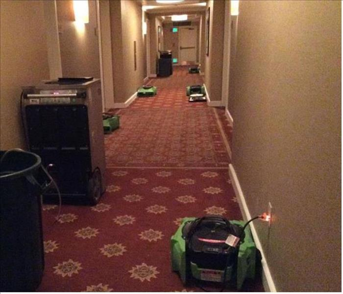 hallway in Broomfield hotel with SERVPRO dehumidifiers and fans